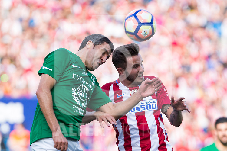 Saul Iniguez and Noureddine Naybet during the last match to be played by Atletico de Madrid at Vicente Calderon Stadium in Madrid, May 28, 2017. Spain.. (ALTERPHOTOS/Rodrigo Jimenez)