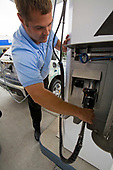 GM employee demonstrates refueling of GM's new Equinox SUV. On June 26, 2008, Shell opened California's first retail hydrogen car refueling station in West Los Angeles. In hydrogen vehicles, an electric motor powers the wheels. A chemical reaction inside a unit called a fuel <br /> cell – usually between hydrogen and oxygen – creates electricity for the motor. Los Angeles, California, USA