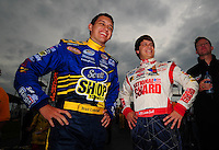 May 31, 2008; Dover, DE, USA; Nascar Nationwide Series driver Brad Coleman (left) and Landon Cassell during the Heluva Good 200 at the Dover International Speedway. Mandatory Credit: Mark J. Rebilas-