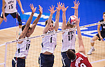 07 MAY 2016: Ben Patch (13), Price Jarman (1), and Jake Langlois (10) of Brigham Young University prepare to block a shot against Ohio State University during the Division I Men's Volleyball Championship held at Rec Hall on the Penn State University campus in University Park, PA.  Ohio State defeated BYU 3-1 for the national title.  Ben Solomon/NCAA Photos