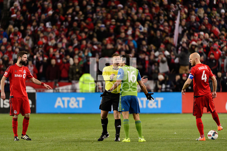 Toronto, ON, Canada - Saturday Dec. 10, 2016: Referee Alan Kelly, Nelson Valdez during the MLS Cup finals at BMO Field. The Seattle Sounders FC defeated Toronto FC on penalty kicks after playing a scoreless game.