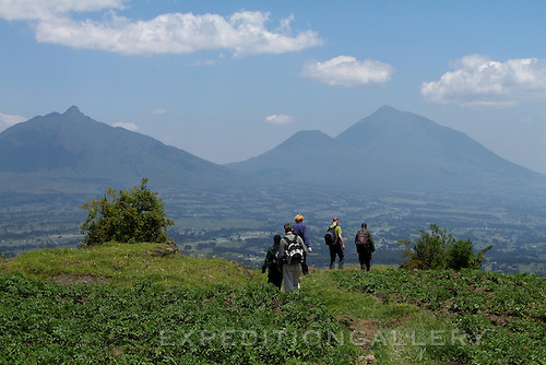 Trekking through rural farmlands on approach to Volcanoes National Park (Parc National des Volcans), Rwanda. [NO MODEL RELEASE]