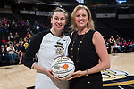 Wake Forest Demon Deacons head coach Jen Hoover (right) presents Elisa Penna (41) a ball to commemorate her 1,000th career point prior to the game against the Virginia Cavaliers at the LJVM Coliseum on February 25, 2018 in Winston-Salem, North Carolina. The Cavaliers defeated the Demon Deacons 48-41. (Brian Westerholt/Sports On Film)