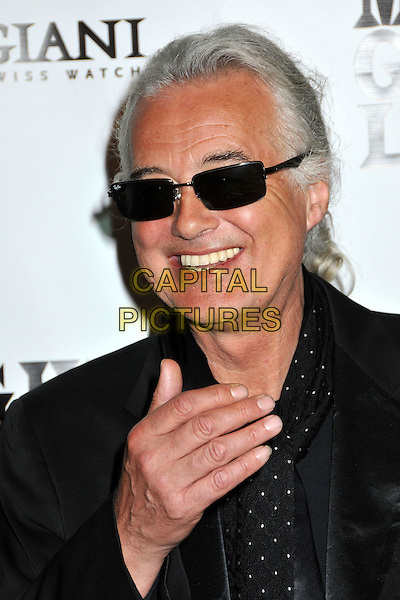 "JIMMY PAGE of Led Zeppelin. .""It Might Get Loud"" Los Angeles Premiere After Party held at the Palomar Hotel, Westwood, CA, USA..June 19th, 2009.headshot portrait black sunglasses shades hand.CAP/ADM/BP.©Byron Purvis/AdMedia/Capital Pictures."