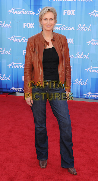 Jane Lynch.American Idol Season 11 Finale - Arrivals held at Nokia Theatre LA Live, Los Angeles, California, USA..May 23rd, 2012.full length brown leather jacket black top jeans denim.CAP/ROT/TM.©Tony Michaels/Roth Stock/Capital Pictures