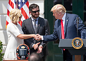 United States President Donald J. Trump, left, shakes hands with Sherry Pollex, left, hosts Martin Truex Jr., the NASCAR Cup Series champion, center, and his team, on the South Lawn of the White House in Washington, DC on Monday, May 21, 2018.  Truex competes full-time in the Monster Energy NASCAR Cup Series for Furniture Row Racing.  Ms. Pollex is the longtime girlfriend of Truex Jr. who has been battling ovarian cancer since 2014.<br /> Credit: Ron Sachs / CNP