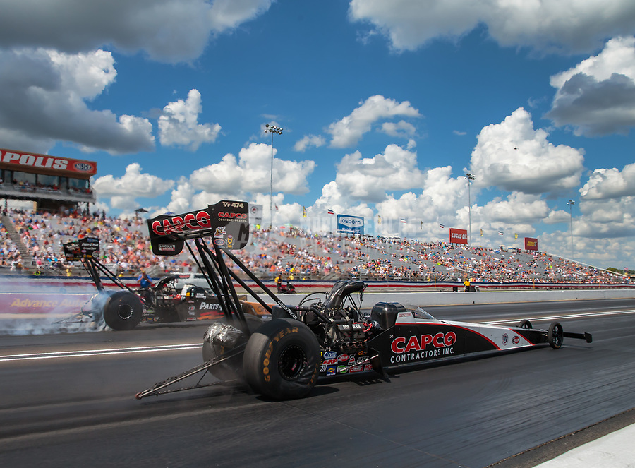 Sep 3, 2018; Clermont, IN, USA; NHRA top fuel driver Billy Torrence (near) races alongside Clay Millican during the US Nationals at Lucas Oil Raceway. Mandatory Credit: Mark J. Rebilas-USA TODAY Sports