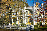 Fall foliage graces the Wedding Cake House in Kennebunk, ME, USA