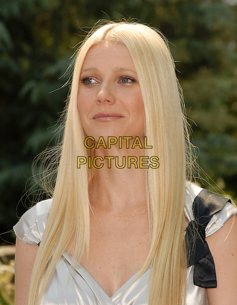 "GWYNETH PALTROW.The Estee Lauder Garden Luncheon in Honor of Gwyneth Paltrow and the ""pleasures by Gwyneth Paltrow"" Limited Edition Launch held at The Greystone Estate in Beverly HIlls, California, USA..September 20th, 2006.Ref: DVS.headshot portrait black bow ribbon.www.capitalpictures.com.sales@capitalpictures.com.©Debbie VanStory/Capital Pictures"