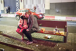 © Joel Goodman - 07973 332324 . No syndication permitted . 01/01/2014 . Manchester , UK . A man and a woman sit on a bench littered with fast food debris .  Revellers see in the New Year in Manchester today (January 1st 2014) as police report that officers are at full stretch responding to calls . Photo credit : Joel Goodman