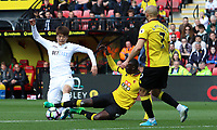 Ki Sung-yueng of Swansea City is challenged by Etienne Capoue of Watford  during the Premier League match between Watford and Swansea City at Vicarage Road Stadium, Watford, England, UK. Saturday 15 April 2017