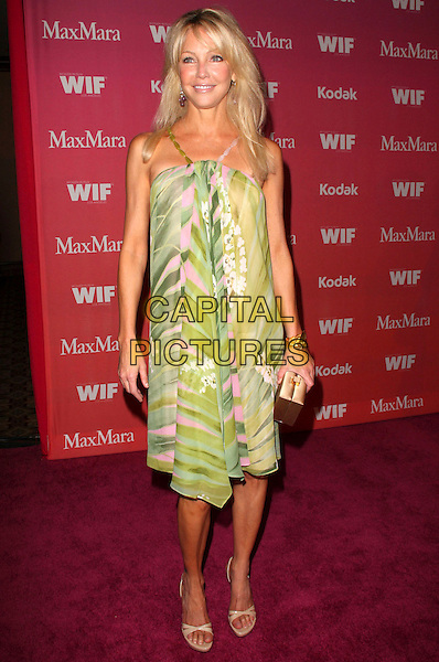 HEATHER LOCKLEAR.2009 Women in Film Crystal + Lucy Awards Arrivals held at Hyatt Regency Hotel, Century City, California, USA..June 12th, 2009.full length dress sandals green pink print straps beads open toe box clutch bag .CAP/ADM/KB.©Kevan Brooks/AdMedia/Capital Pictures.