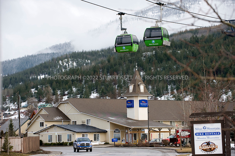 3/20/2008--Kellogg, ID, USA..Cable cars to ski runs in Kelllogg, Idaho, in the Silver Valley. With the price of silver climbing, Idaho's once struggling silver mining industry is making a comeback...Sunshine Mine is situated in the Coeur d'Alene Mining District of North Idaho at Big Creek, 8 miles southeast of Kellogg, Shoshone County, Idaho. The mine has produced more than 365 million ounces from 1884 until its closure in early 2001. It was discovered and initially mined on a small-scale by True and Dennis Blake, and then passed into corporate hands after their deaths in the early 1900s. Sunshine Mining Company owned and operated the mine in subsequent decades and produced silver from at least 7 vein systems. Two of these vein systems, Sunshine and Chester, have each produced more than 100 million ounces of silver to date. The mine closed in 2001 because of low silver prices...Sterling Mining Company acquired the rights to the Sunshine Mine in 2003 and has reopened the mine, hiring local residents to come back to mine...©2008 Stuart Isett. All rights reserved.