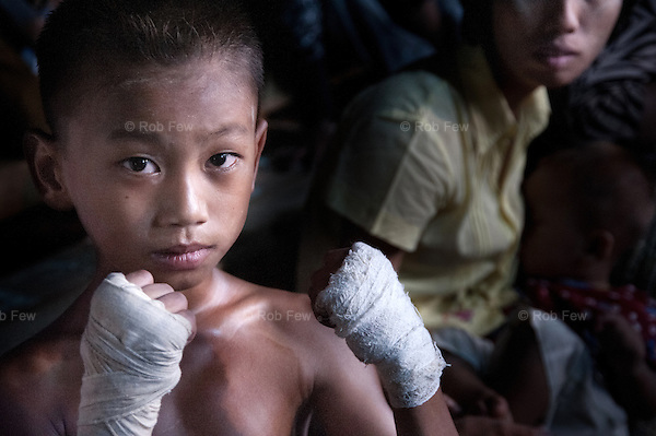 In the run-up to Songkran, 2010, Thai boxers and fighters from a Burmese militia group allied to the Junta met for a series of matches in Myawaddy, just across the Thai-Burma border. <br /> <br /> The fights were held inside a makeshift palisade at the top of town and conducted under Burmese rules, which means no gloves and a lot of blood.