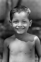 Young boy from the community of Nueva Esperanza, El Salvador, 1999.