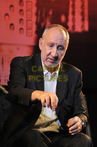 Pete Townshend.'Quadrophenia - The Director's Cut' playback with Q & A and acoustic performance at Bush Hall, Shepherd's Bush, London, England. .9th November 2011.half length sitting hand looking down black suit jacket white shirt beard facial hair .CAP/MAR.© Martin Harris/Capital Pictures.