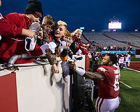 Hawgs Illustrated/BEN GOFF <br /> De'Jon Harris, Arkansas linebacker, gives his cleats to fans after the game vs Missouri Saturday, Nov. 29, 2019, at War Memorial Stadium in Little Rock.