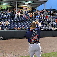 Catcher Ryan Query (25) of the Rome Braves plays catch with members of the crowd during a rain delay before a game against the Greenville Drive on July 5, 2012, at Fluor Field at the West End in Greenville, South Carolina. The game eventually was postponed due to rain. (Tom Priddy/Four Seam Images)