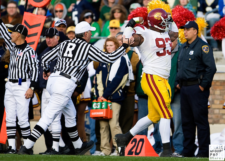 10/17/09 - South Bend, IN:  USC defensive end Everson Griffen gets flagged for excessive celebration following a sack on Notre Dame's Jimmy Clausen during their game at Notre Dame Stadium on Saturday.  USC won the game 34-27 to extend its win streak over Notre Dame to 8 games.  Photo by Christopher McGuire.