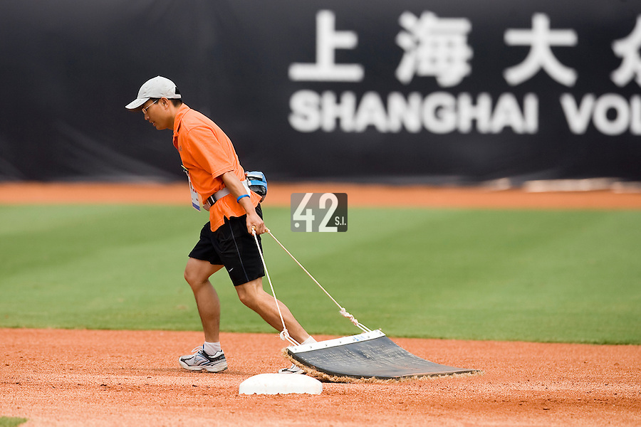 18 August 2007: Chinese staff works on the field prior to the China 5-1 victory over France in the Good Luck Beijing International baseball tournament (olympic test event) at the Wukesong Baseball Field in Beijing, China.
