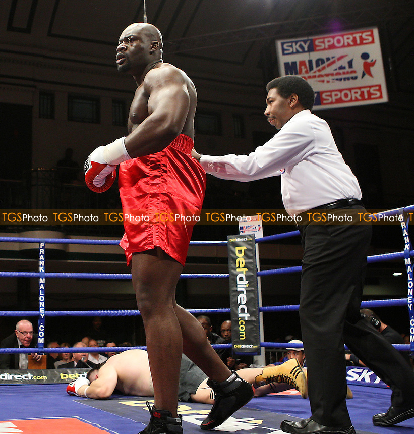 Larry Olubamiwo (Hackney, red shorts) defeats Vlado Szabo (black shorts) in a Heavyweight boxing contest at York Hall, Bethnal Green, promoted by FTM Sports/Maloney Promotions -  17/10/08 - MANDATORY CREDIT: Gavin Ellis/TGSPHOTO - Self billing applies where appropriate - Tel: 0845 094 6026
