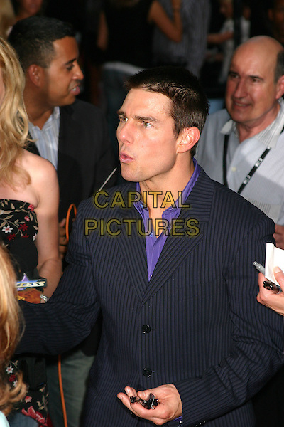 "TOM CRUISE.""Collateral"" Premiere - New York - Arrivals.New York City, New York .August 4, 2004.half length, funny face, pinstripe.www.capitalpictures.com.sales@capitalpictures.com.©Capital Pictures"