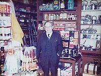 Pictured: Former store owner R L Ryder at Hafod Hardware store in Rhayader, mid Wales, UK. <br /> Re: Shop owner Thomas Lewis Jones has made a Christmas advert starring Arthur Lewis Jones, his two-year-old son costing only £100.<br /> Hafod Hardware in Rhayader, Powys, has been making festive adverts for several years.<br /> This year's advert sees Arthur setting up the shop along with members of his family.