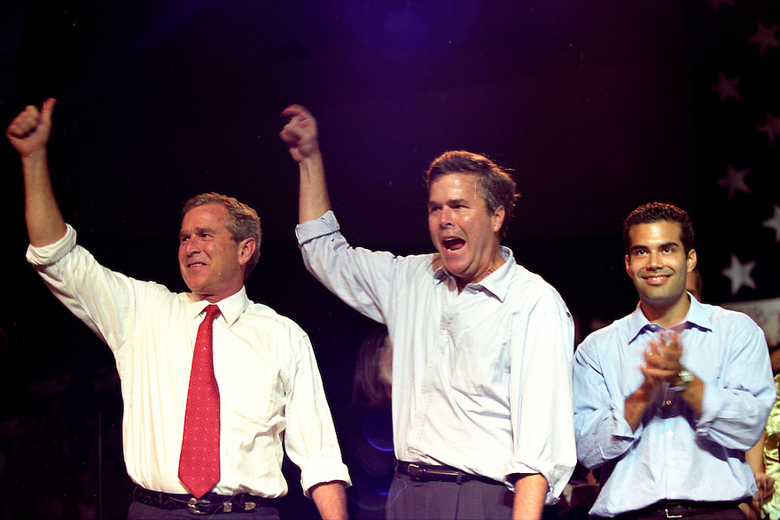 Republican Presidential candidate George W. Bush attends a rally in Tampa with his brother, Florida Governor Jeb Bush and nephew George P. Bush.