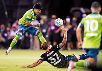 10th July 2020, Orlando, Florida, USA;  Seattle Sounders forward Raul Ruidiaz (9) shoots the ball as San Jose Earthquakes defender Guram Kashia (37) goes to block the shoot During the MLS Is Back Tournament between the Seattle Sounders v San Jose Earthquakes on July 10, 2020 at the ESPN Wide World of Sports, Lake Buena Vista FL.