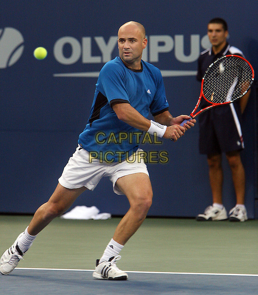 ANDRE AGASSI .Atmosphere before 2005 US Open Tennis Men's Championship starts, Flushing, NY. .September 11th, 2005.Photo Credit Jackson Lee/Admedia.full length sport blue shirt racket .www.capitalpictures.com.sales@capitalpictures.com.© Capital Pictures.