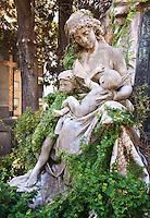 A sculpture decorates a tomb in the Cementario de la Recoleta in Buenos Aires.