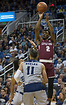 Little Rock guard Deondre Burns (2) shoots against Nevada in the first half of an NCAA college basketball game in Reno, Nev., Friday, Nov. 16, 2018. (AP Photo/Tom R. Smedes)