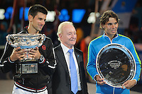 MELBOURNE, 30 JANUARY - Rafael Nadal (ESP) and Novak Djokovic (SRB) pose for pictures with their trophies and Rod Laver at the men's finals match on day 14 of the 2012 Australian Open at Melbourne Park, Australia. (Photo Sydney Low / syd-low.com)