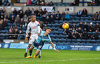 Paris Cowan-Hall of Wycombe Wanderers goes down in the penalty area under a Lewis Young of Crawley Town challenge during the Sky Bet League 2 match between Wycombe Wanderers and Crawley Town at Adams Park, High Wycombe, England on 25 February 2017. Photo by Andy Rowland / PRiME Media Images.