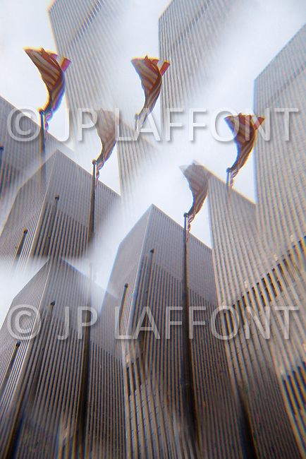 World Trade Center with an optical effect and the United States  flag in the foreground.