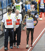Photo: Ady Kerry/Richard Lane Photography..Aviva Grand Prix. 21/02/2009. .Bernard Lagat walks off with an ice pack after his 1500m race