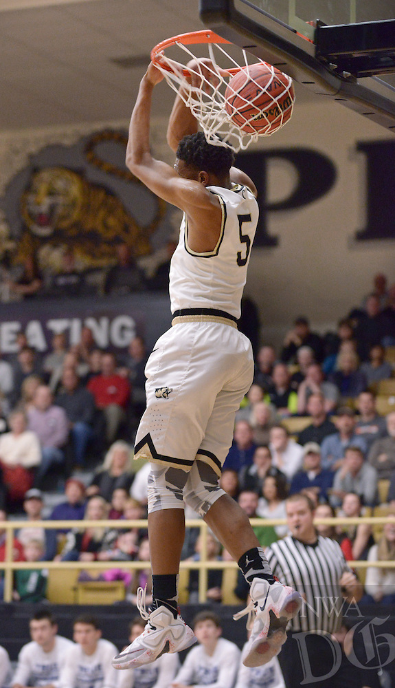 NWA Democrat-Gazette/BEN GOFF @NWABENGOFF<br /> Malik Monk of Bentonville dunks against Rogers on Saturday Jan. 23, 2016 during the game in Bentonville's Tiger Arena.