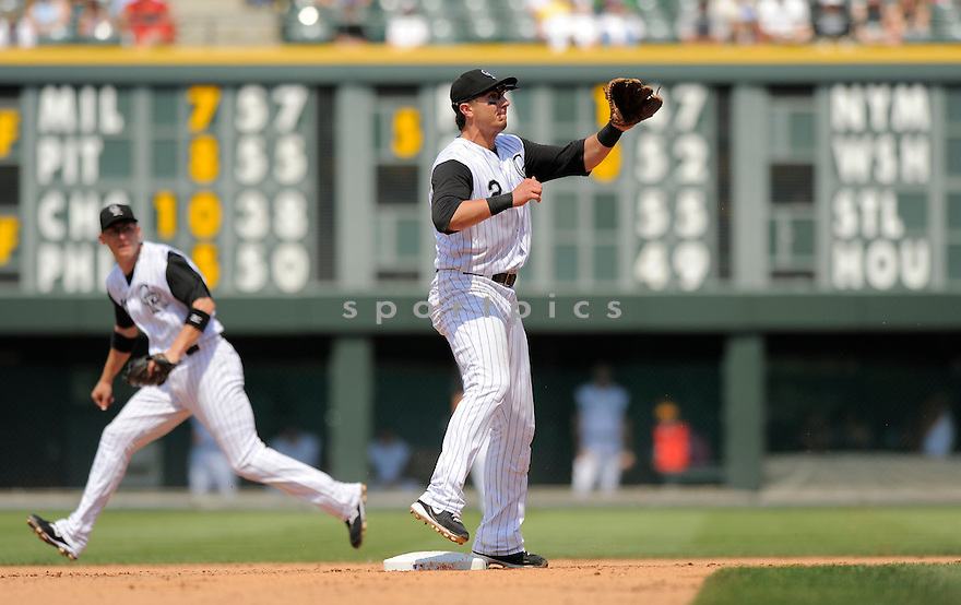 TROY TULOWITZKI, of the Colorado Rockies  in action during the Rockies game against the Arizona Diamondbacks.  The Rockies  beat the Diamondbacks 5-4 in Denver, Colorado on July 21, 2009...David Durochik / SportPics