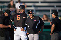 Lake Elsinore Storm manager Edwin Rodriguez (21) goes over the ground rules with Modesto Nuts manager Mitch Canham (6) before a California League game against the Modesto Nuts at John Thurman Field on May 11, 2018 in Modesto, California. Modesto defeated Lake Elsinore 3-1. (Zachary Lucy/Four Seam Images)