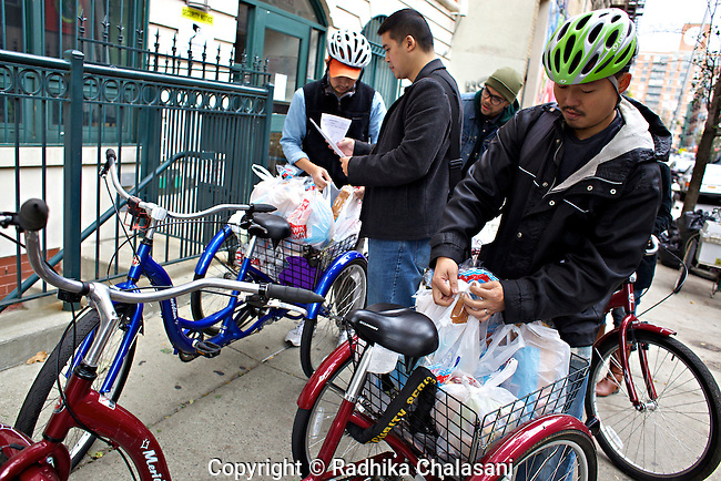 NEW YORK-NOVEMBER 02:  Staff and volunteers with Asian Americans for Equality load up tricycles with groceries for homebound residents of the organizations buildings in the aftermath of Hurricane Sandy November 2, 2012. Thousands of volunteers were working on the lower east side as the area remained without electricity.