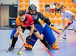 ROTTERDAM  - NK Zaalhockey,   wedstrijd om brons.  heren Oranje Rood- Kampong. OR wint.  Jim van de Venne (Oranje-Rood) met David Wolff (Kampong).       COPYRIGHT KOEN SUYK