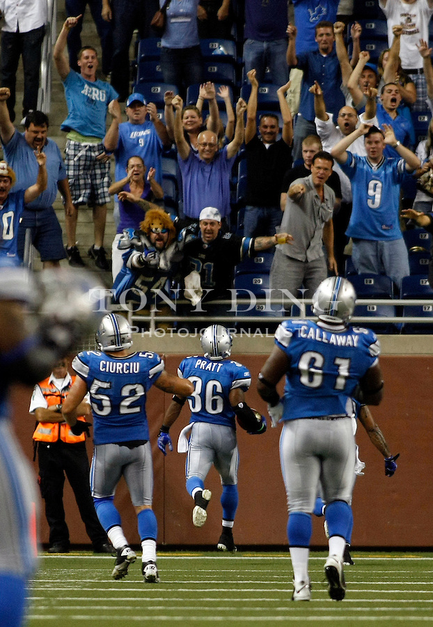 Fans celebrate a 102 yard touchdown from interception by Detroit Lions cornerback Paul Pratt (36), in the fourth quarter of a preseason NFL football game with the Buffalo Bills, Thursday,  Sept. 2, 2010, in Detroit. The Lions won 28-23. (AP Photo/Tony Ding)