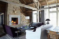 Hand-selected beams from an old Wisconsin dairy barn are a feature of the contemporary living room