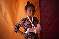 A girl receives treatment at a medical camp in Sindhupalchok, outskirt of Kathmandu, Nepal. May 1, 2015