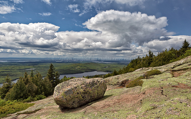 An approaching storm is seen above a glacial erratic atop Cadillac Mountain in Acadia National Park, Maine.