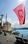 Turkish flag and Ortakoy Mosque at Bosphorus Sea in Istanbul, Turkey