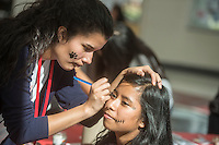 NWA Democrat-Gazette/ANTHONY REYES &bull; @NWATONYR<br /> Celina Moreno (left) paints a skull pattern on Sayuri Jimenez's face, both students at Springdale High School, Monday, Nov. 2, 2015 for a Day of the Dead celebration at the school. The celebration featured a mural that students were encouraged to write what they wanted to do before they died on and were several altars prepared for different figures in history. The Day of the Dead holiday focuses on gatherings of family and friends to pray for and remember friends and family members who have died, and help support their spiritual journey.