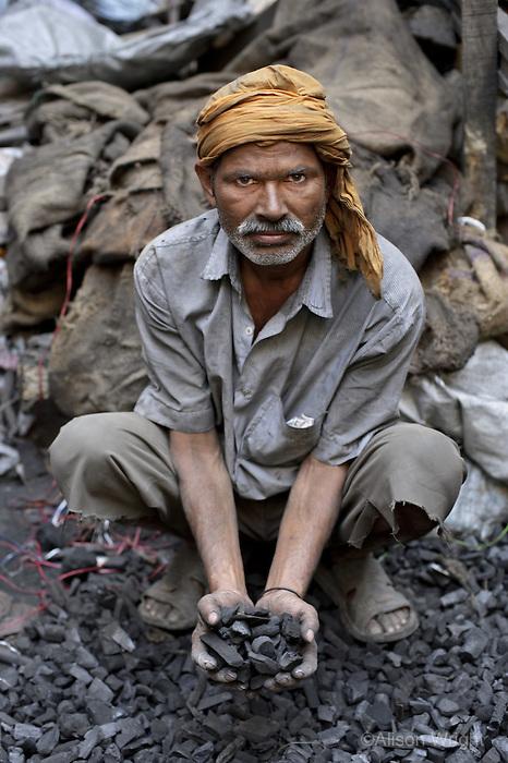man with coal, Amritasr, India, 2011