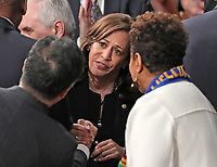 United States Senator Kamala Harris (Democrat of California) in discussion with her colleagues prior to US President Donald J. Trump delivering his second annual State of the Union Address to a joint session of the US Congress in the US Capitol in Washington, DC on Tuesday, February 5, 2019. Photo Credit: Alex Edelman/CNP/AdMedia