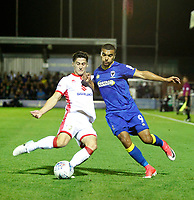 Milton Keynes' George Williams and AFC Wimbledon's Liam Trotter contest the ball during the Sky Bet League 1 match between AFC Wimbledon and MK Dons at the Cherry Red Records Stadium, Kingston, England on 22 September 2017. Photo by Carlton Myrie / PRiME Media Images.
